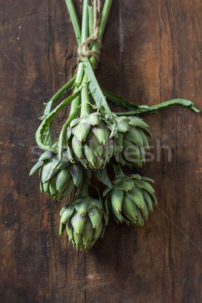 Supplies and materials for artichoke bouquet on wooden backgroun Stock photo © artsvitlyna