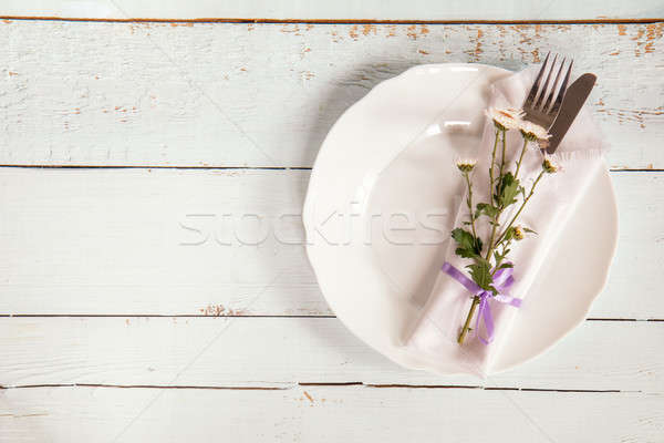 Stock photo: White empty plate, pink chrysanthemum flowers, napkin, fork and