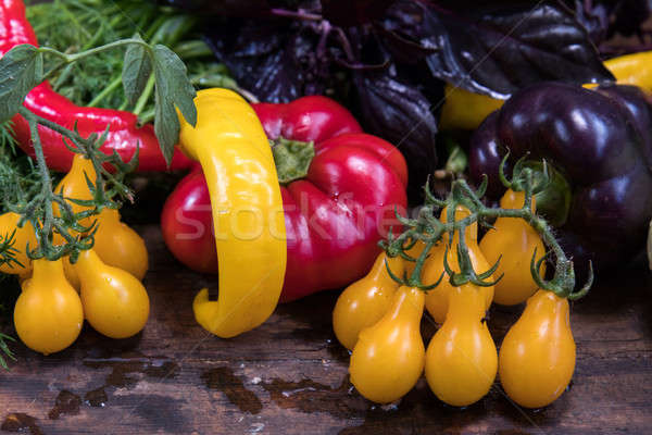 Red and purple sweet pepper and yellow tomatoes Stock photo © artsvitlyna