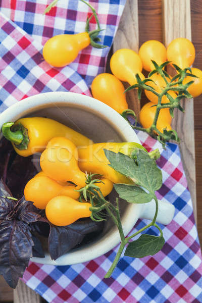 Yellow hot pepper and yellow tomatoes with purple basil Stock photo © artsvitlyna