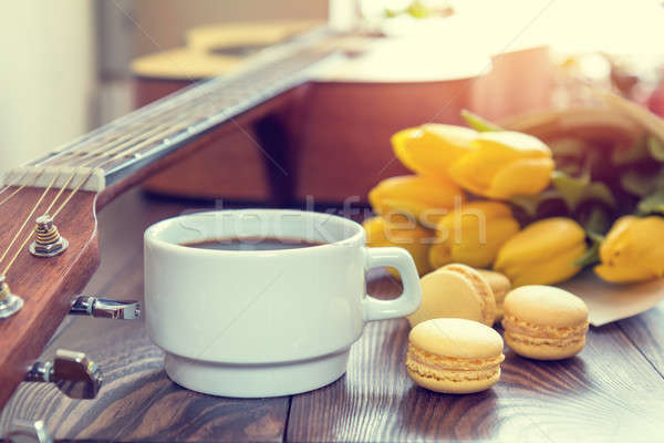 Stock photo: Beautiful spring music background. Cup of coffww, guitar, yellow