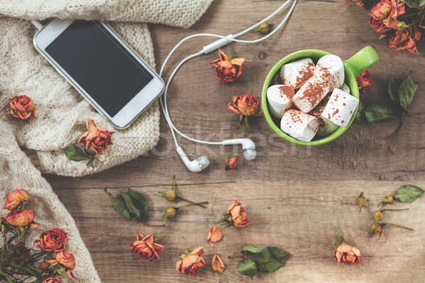 Cup of coffee with marshmallow, white knitting wool, dried roses Stock photo © artsvitlyna