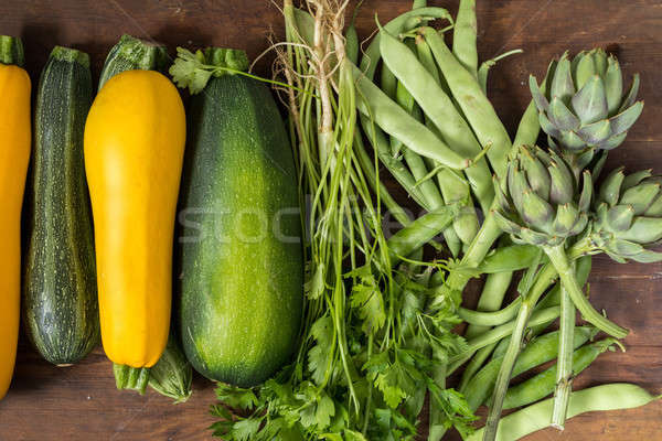 Stock photo: Fresh organic green vegetables on wooden floor