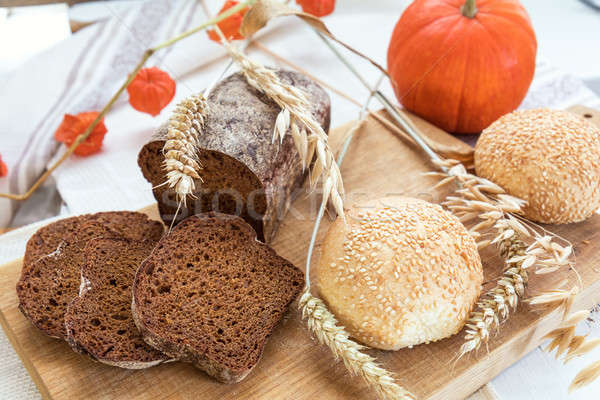 Freshly baked breads with ears and pumpkin Stock photo © artsvitlyna