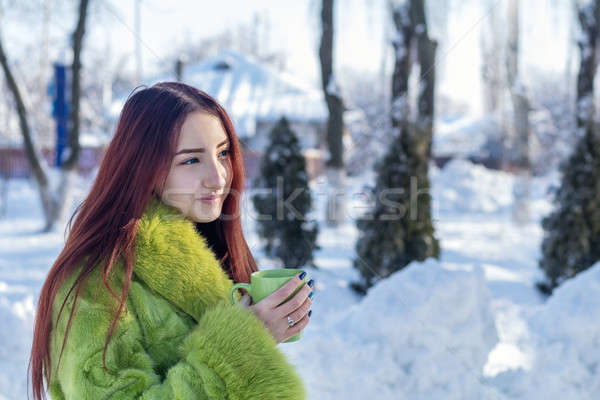 Stock photo: Beautiful cute pretty redhead female teenager in a green fur coa