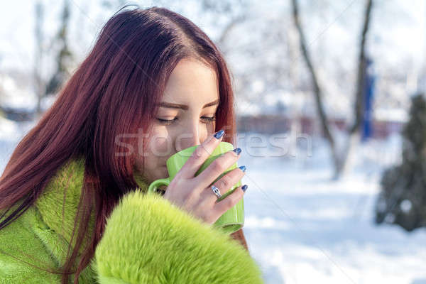 Beautiful cute pretty redhead female teenager in a green fur coa Stock photo © artsvitlyna