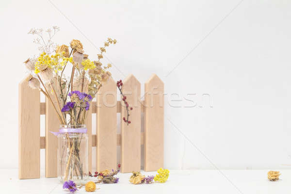 Stock photo: Composition of dried flowers and decoration on white cracked wal