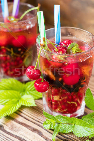 Glasses of refreshing drink flavored with fresh fruit and decora Stock photo © artsvitlyna