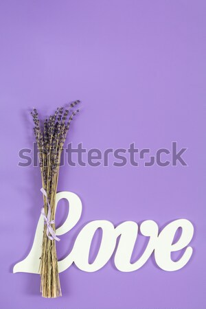 Stock photo: Beautiful dried lavender bouquet on violet pink surface.