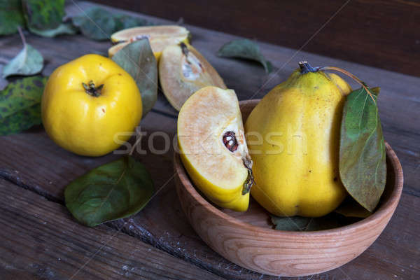 Fresh quince fruit on dark wooden table Stock photo © artsvitlyna