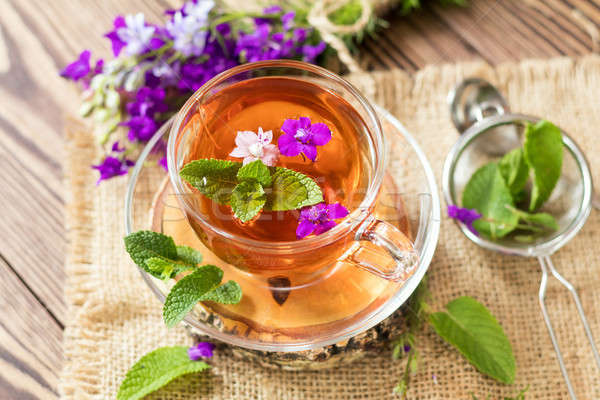 Stock photo: Glass cup of summer tea with herbs