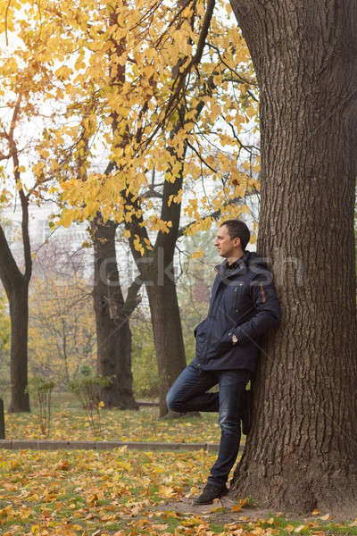 Handsome man in the autumn park Stock photo © artsvitlyna