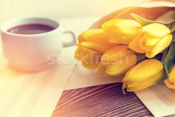 Stock photo: Beautiful spring music background. Cup of coffee, yellow tulips,