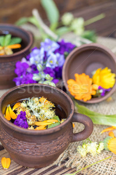 Ceramic cups of healthy herbal tea Stock photo © artsvitlyna