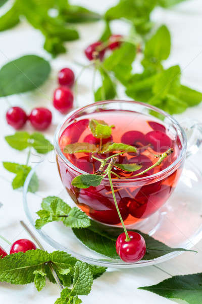 Fruit cherry drink in transparent glass cup Stock photo © artsvitlyna