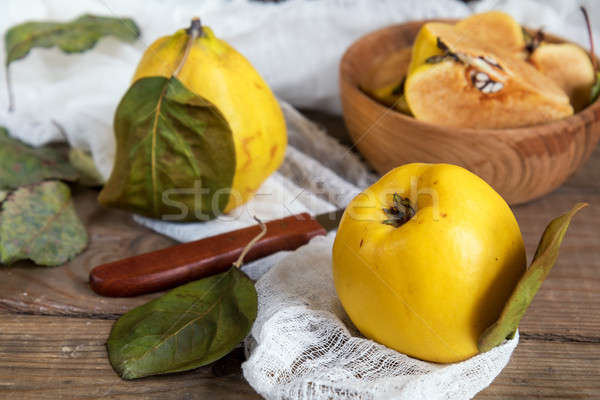 Fresh quince fruit on dark wooden table Stock photo © artsvitlyna