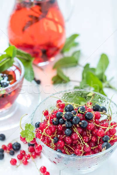 Stock photo: Fresh red and black currant in glass vase