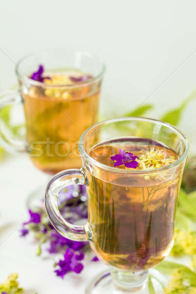 Linden herbal tea in transparent grog glass Stock photo © artsvitlyna