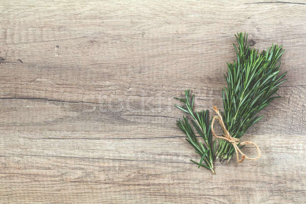 Stock photo: Rosemary bunch of bouquets on light wooden surface. Top view, co