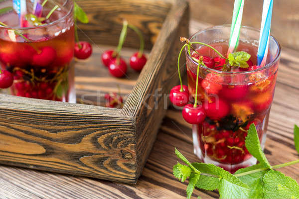 Glasses of refreshing  drink flavored with fresh fruit and decor Stock photo © artsvitlyna