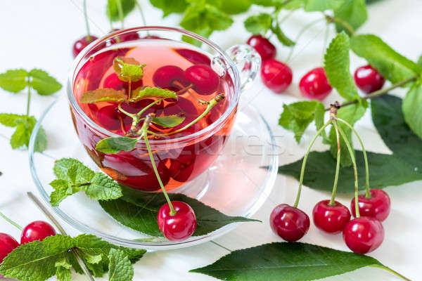 Stock photo: esh fruit cherry drink in transparent glass cup surrounded by ch