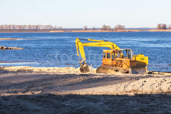 Excavator or digger and excavators working on ground. Industrial Stock photo © artsvitlyna
