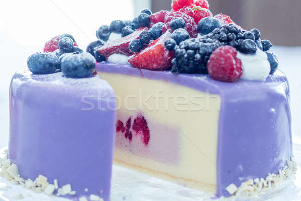 Tasty Ice-cream cake with fresh berries on a glass plate. Light  Stock photo © artsvitlyna