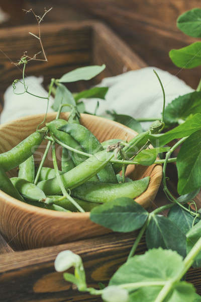 Stock photo: Pods of green peas and pea on dark wooden surface
