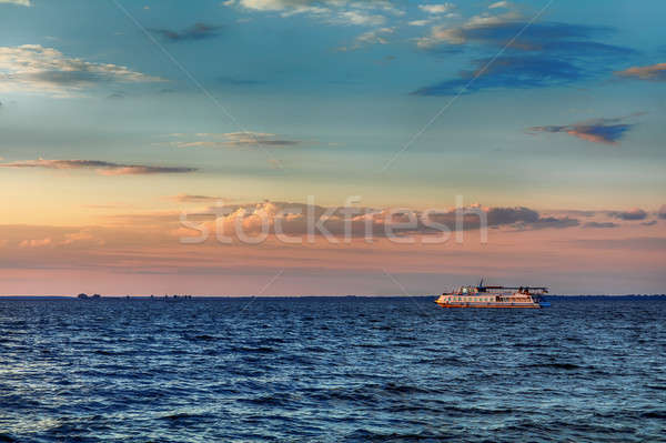 Stock photo: Beautiful evening sky before sunset over the river with