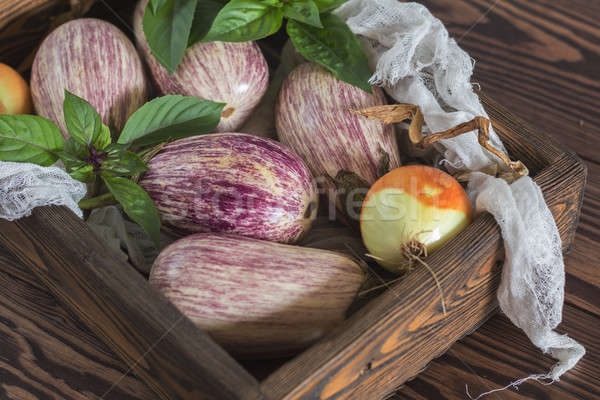 Stock photo: Purple graffiti eggplants, onion and basil