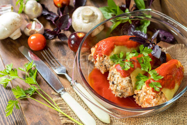 Cooked stuffed pepper served in a transparent glass pot Stock photo © artsvitlyna