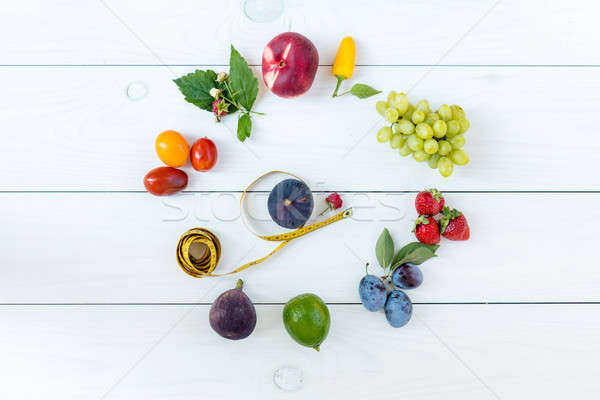 Fitness healthy food on white wooden background (lime, strawberr Stock photo © artsvitlyna