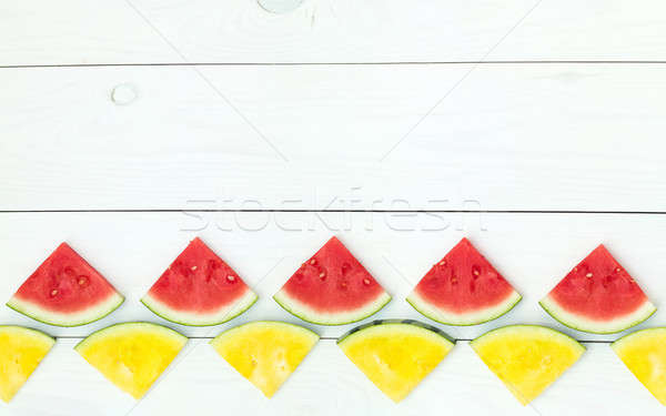 Red and yellow watermelon slices on sticks Stock photo © artsvitlyna
