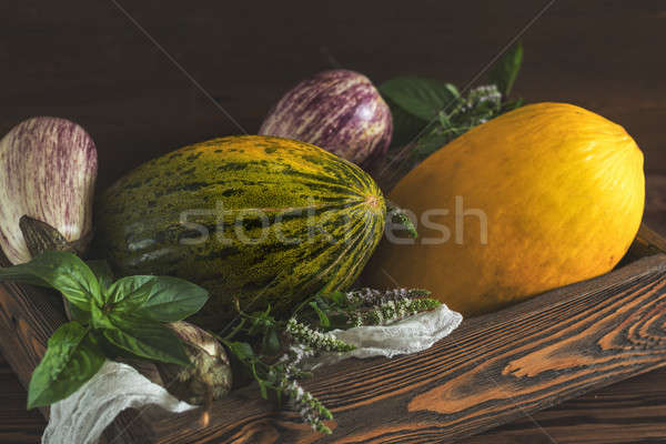 Melon, basil, mint, purple graffiti eggplants, onion and green f Stock photo © artsvitlyna