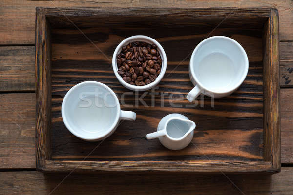 Stock photo: Cups of coffee on dark wooden background.