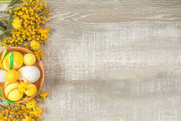 Easter holiday composition in yellow colors with spring flowers. Stock photo © artsvitlyna