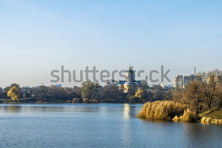 Autumn Landscape. City with the church across the river Stock photo © artsvitlyna
