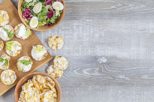 Delicious, nutritious cereal breads with cream cheese on kitchen Stock photo © artsvitlyna