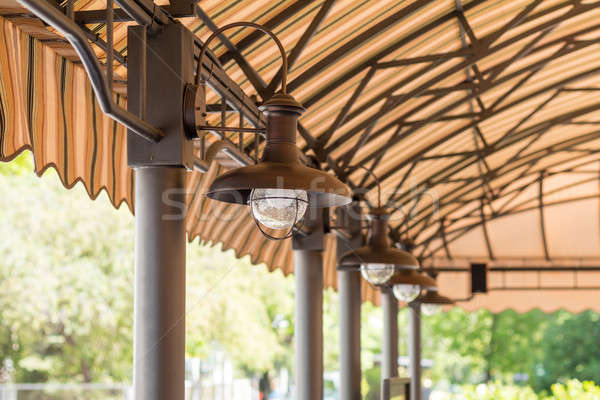 Stock photo: Streetlights under the summer cafeteria canopy. Architectural co