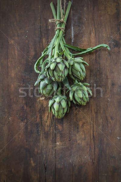 Artichoke bouquet on wooden background Stock photo © artsvitlyna
