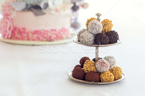 Stock photo: Pyramid of chocolate balls. Chocolate candies covered with icing