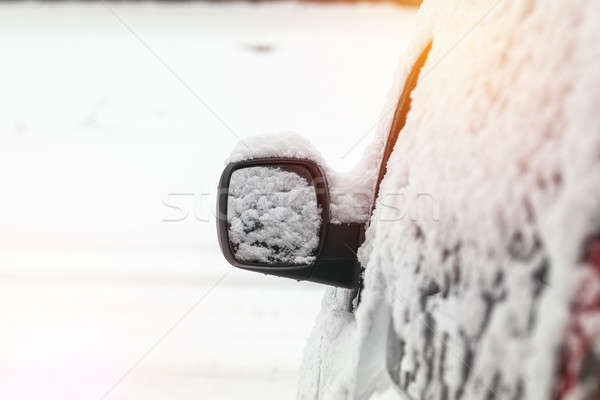 The car is all covered with snow. Snow on rearview mirror. Conce Stock photo © artsvitlyna