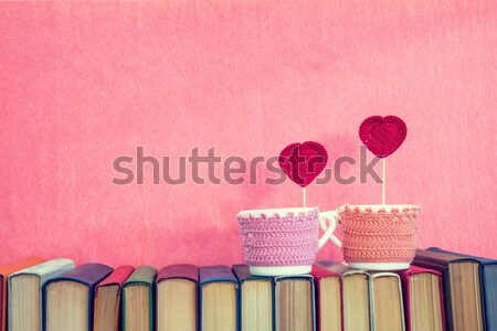 Stock photo: Sea shells on multicolored books at pink background. Education c