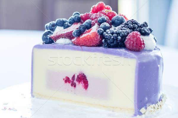 Tasty Ice-cream cake with fresh berries on a glass plate. Light  Stock photo © artsvitlyna