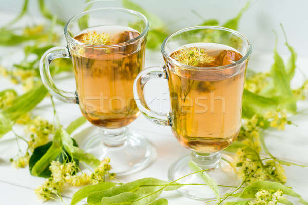 Linden tea in transparent grog glass Stock photo © artsvitlyna