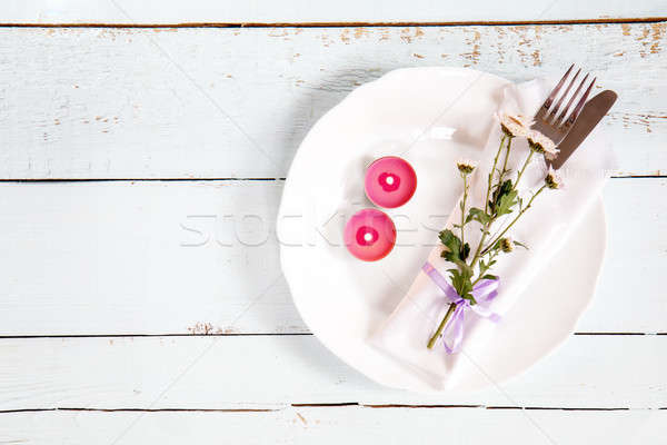 Stock photo: White empty plate, pink chrysanthemum flowers, two pink candles,