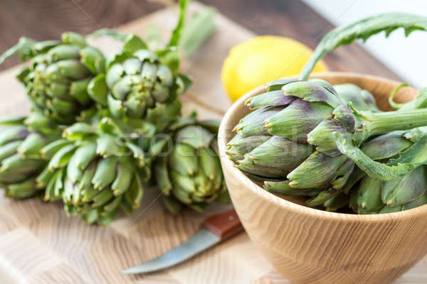 Stock photo: Two artichoke bouquets on kitchen table among some kitchen items
