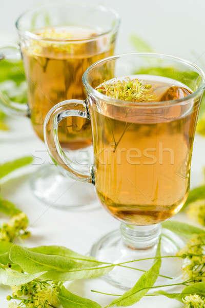 Linden tea in transparent grog glass Stock photo © artsvitlyna