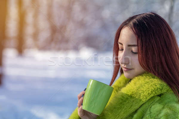 Beautiful cute pretty redhead female teenager in a green fur coa Stock photo © artsvitlyna