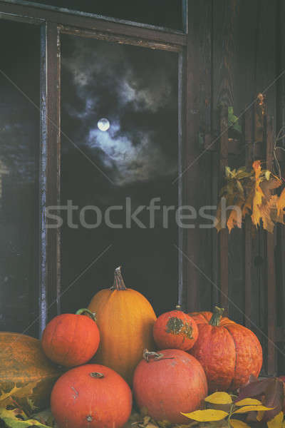 Stock photo: Halloween' pumpkins in the full moon light in a dark room